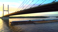 Close up of barge going under bridge on Mississippi River Stock Footage