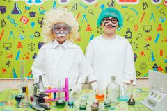 Two boys doing chemical experiments in the laboratory Stock Photos