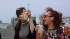 Friends having rooftop party - stock footage