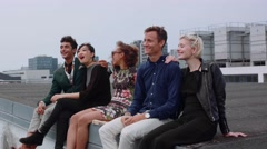 Group of people sitting in terrace at evening - stock footage