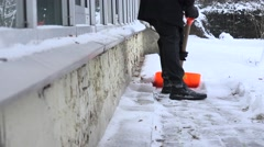Man clean snow with a shovel in winter time. 4K Stock Footage