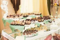 Delicious wedding reception candy bar dessert table - stock photo