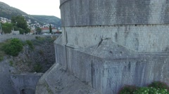 Aerial view of the old city of Dubrovnik before sunrise Stock Footage