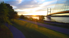 Scenic jib shot of sunrise on Mississippi River Stock Footage