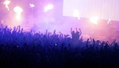 Crowd at concert and blurred stage lights Stock Photos