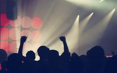 Crowd at concert and blurred stage lights - stock photo