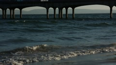 Ocean Pier and waves in the sun (Bournemouth Pier) Stock Footage