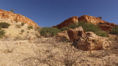 Sandstone rock landscape along the dry Auob river, Kalahari Desert, Namibia Stock Footage
