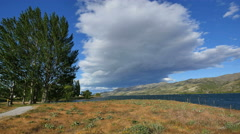 New Zealand cloud looming over Lake Dunstan Stock Footage