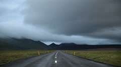 Storm clouds passing over mountain road Icelandic highlands 4k Stock Footage