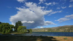 New Zealand cloud and willows by Lake Dunstan Stock Footage