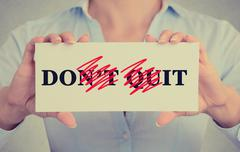 Closeup hands sign don't quit do it message Stock Photos