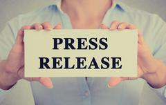 Businesswoman hands holding card sign with press release message Stock Photos