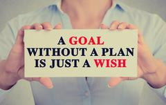 woman hands holding sign with a goal without plan is just wish message - stock photo