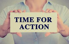 Businesswoman hands holding card sign with time for action message Stock Photos