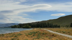 New Zealand path and wave clouds Lake Dunstan Stock Footage