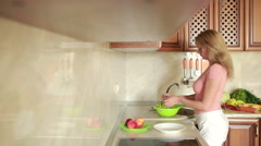 girl washes grapes. vegetables on the kitchen table. tomatoes and cabbage - stock footage
