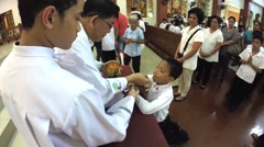 Young boy receives sacrament of communion Stock Footage