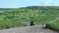 Offroad bus goes along power line, Kamchatka Stock Footage