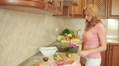 Woman prepares the meat in the kitchen. home cooking dinner. Beef steaks Stock Footage
