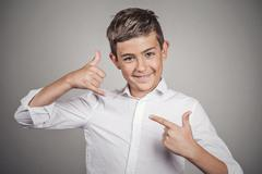 Happy guy, teenager making call me gesture with hand Stock Photos