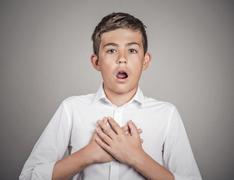 Man shocked surprised in disbelief hands on chest Stock Photos