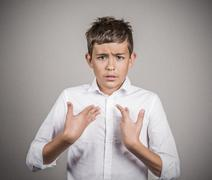 Confused unhappy boy asking you talking to me? - stock photo