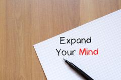 Expand your mind on notebook Stock Photos