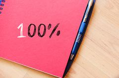One hundred percent symbol on notebook Stock Photos