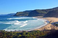 Cliffs and vegetation surrounding Garie beach Stock Photos