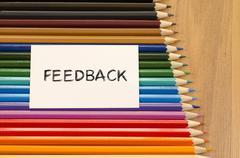 Feedback text concept over pencil background Stock Photos