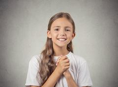 teenager girl gesturing with clasped hands, pretty please - stock photo