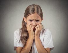 Scared, shy teenager girl - stock photo