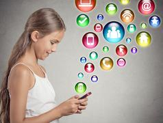 teenager girl using texting on smartphone - stock photo