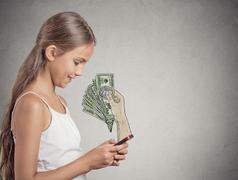 Girl working online on smartphone earning money Stock Photos