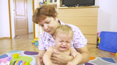 Child was crying in my grandmother at the hands of close-up. Sad baby  crying Arkistovideo