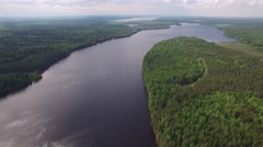 Large river aerial flightower. Beautiful Russian nature. Pine forest from above. Stock Footage