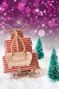 Vertical Sleigh On Purple Background, Feliz Navidad Means Merry Christmas Stock Photos