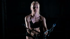 Young fitness woman exercising Cable Crossover. Girl in the gym Stock Footage