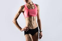 Fitness girl with ideal body Stock Photos