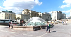 Group of fountains on Manezh square, the girl with the green backpack Stock Footage