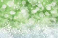 Green Christmas Background With Snow, Stars And Bokeh - stock illustration