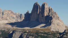 Pan dolomite alps to three peaks close Stock Footage