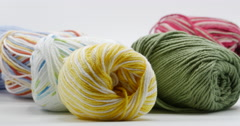 Colorful Yarn Rolls Isolated on White Panning Slow, 4K Stock Footage