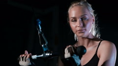 Close UP  Young strong girl pumping triceps  Fitness woman in the gym Stock Footage