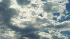 Huge Clouds Above Lit Up By Sun Stock Footage