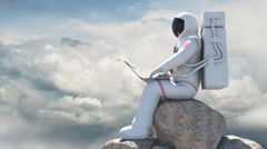 Astronaut Sitting On A Rock And Working With Computer Stock Footage