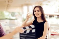 Happy Actress Holding a Glass in Movie Scene Stock Photos