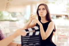 Upset Actress Holding a Glass in Movie Scene Stock Photos