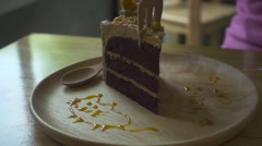 Broken by Wooden Fork Piece of Cake Falls on a Plate. Slow Motion Stock Footage